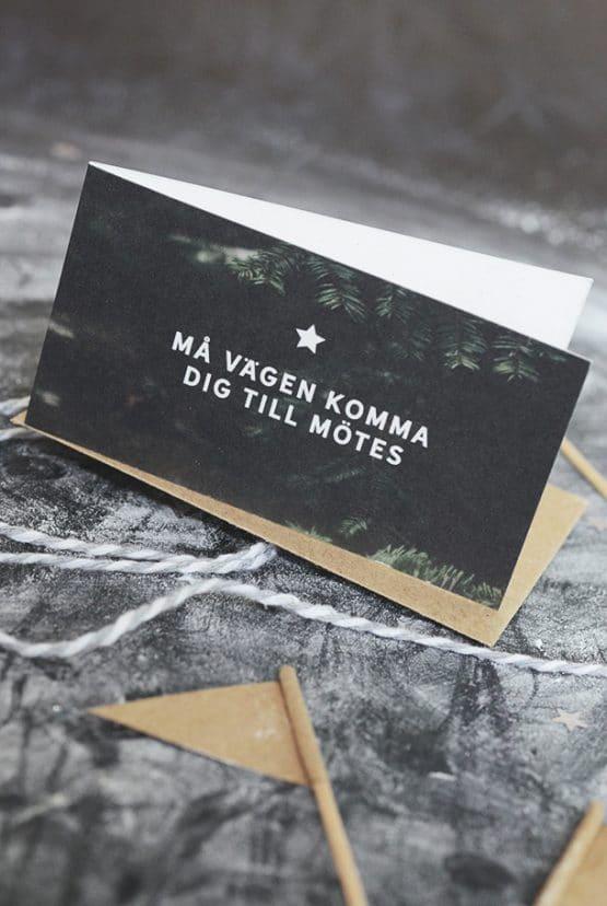 Litet dubbelt kort med kuvert av returpapper: Må vägen komma dig till mötes