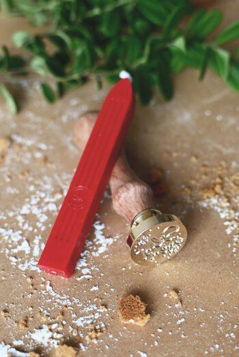 Röd lackstång med veke